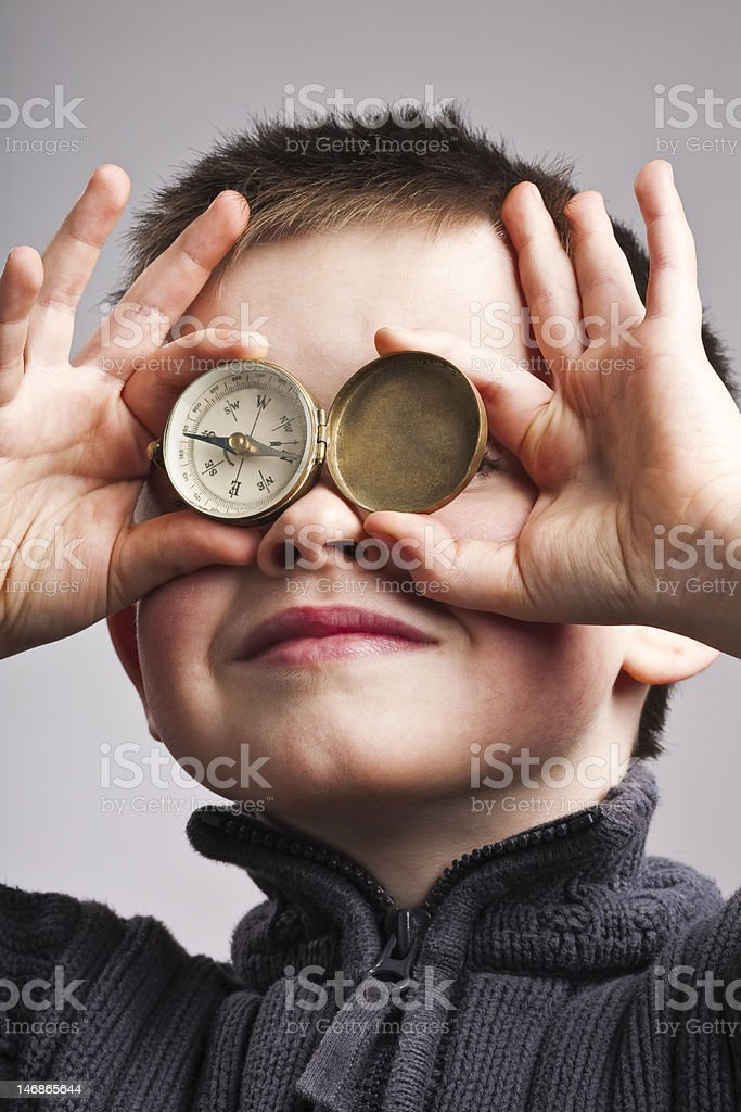 Little boy with compass stock photo