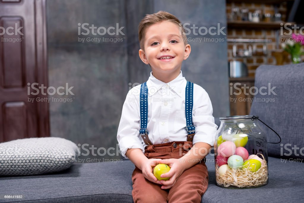 Little boy with Easter eggs stock photo