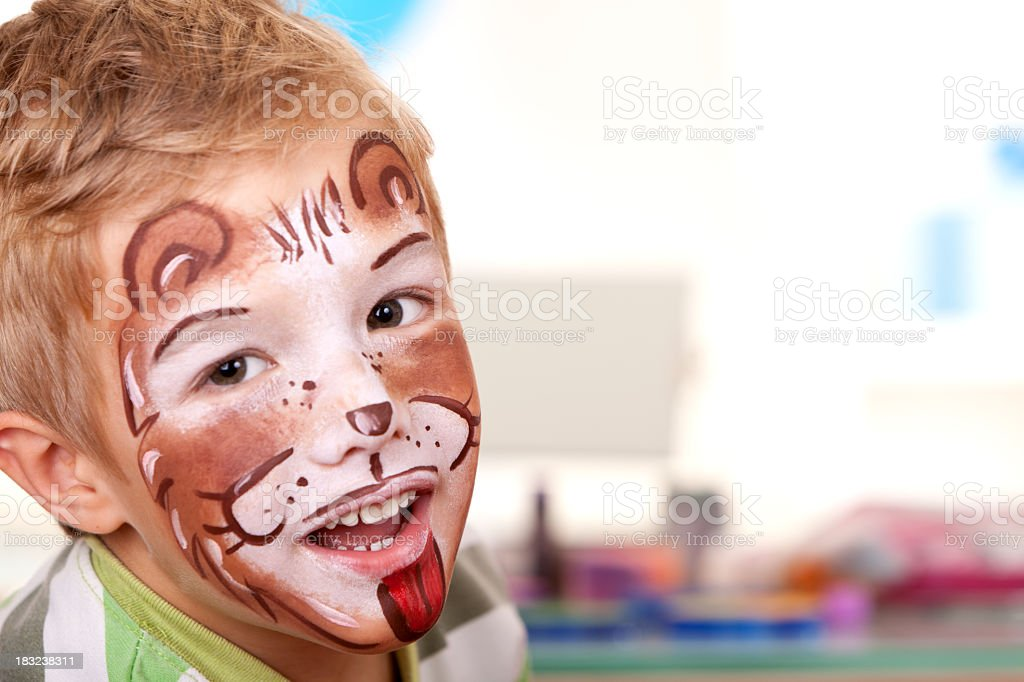 Little boy with face painted on birthday party royalty-free stock photo