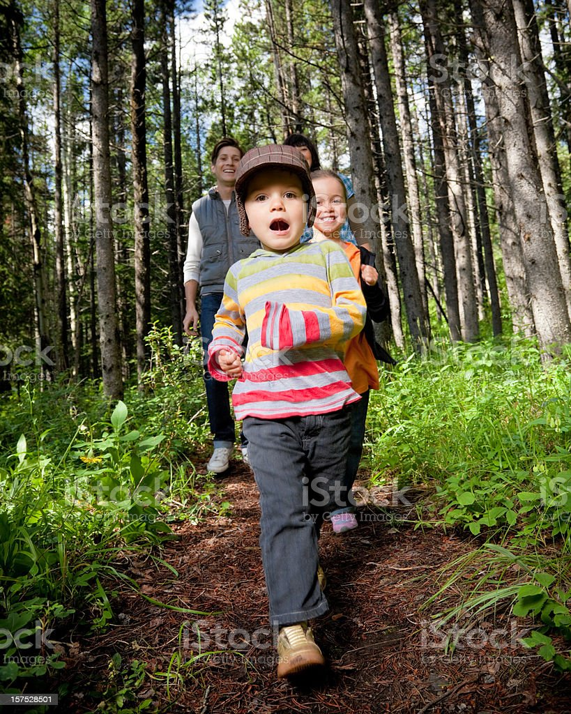 Little Boy with Family in the Forest royalty-free stock photo