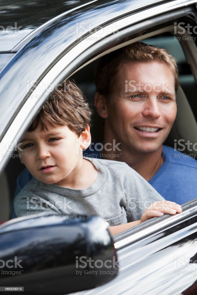 Little boy with father in car driver's seat stock photo