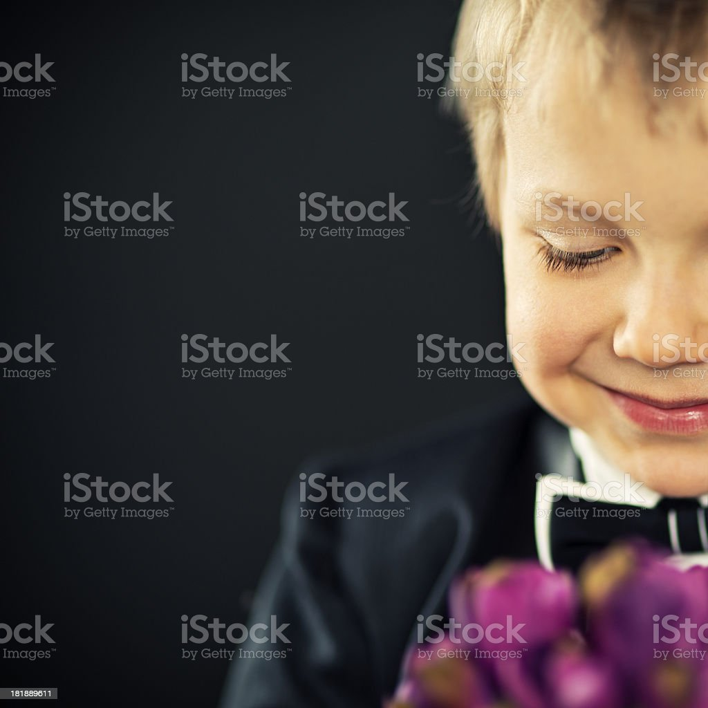 Little boy with flowers royalty-free stock photo