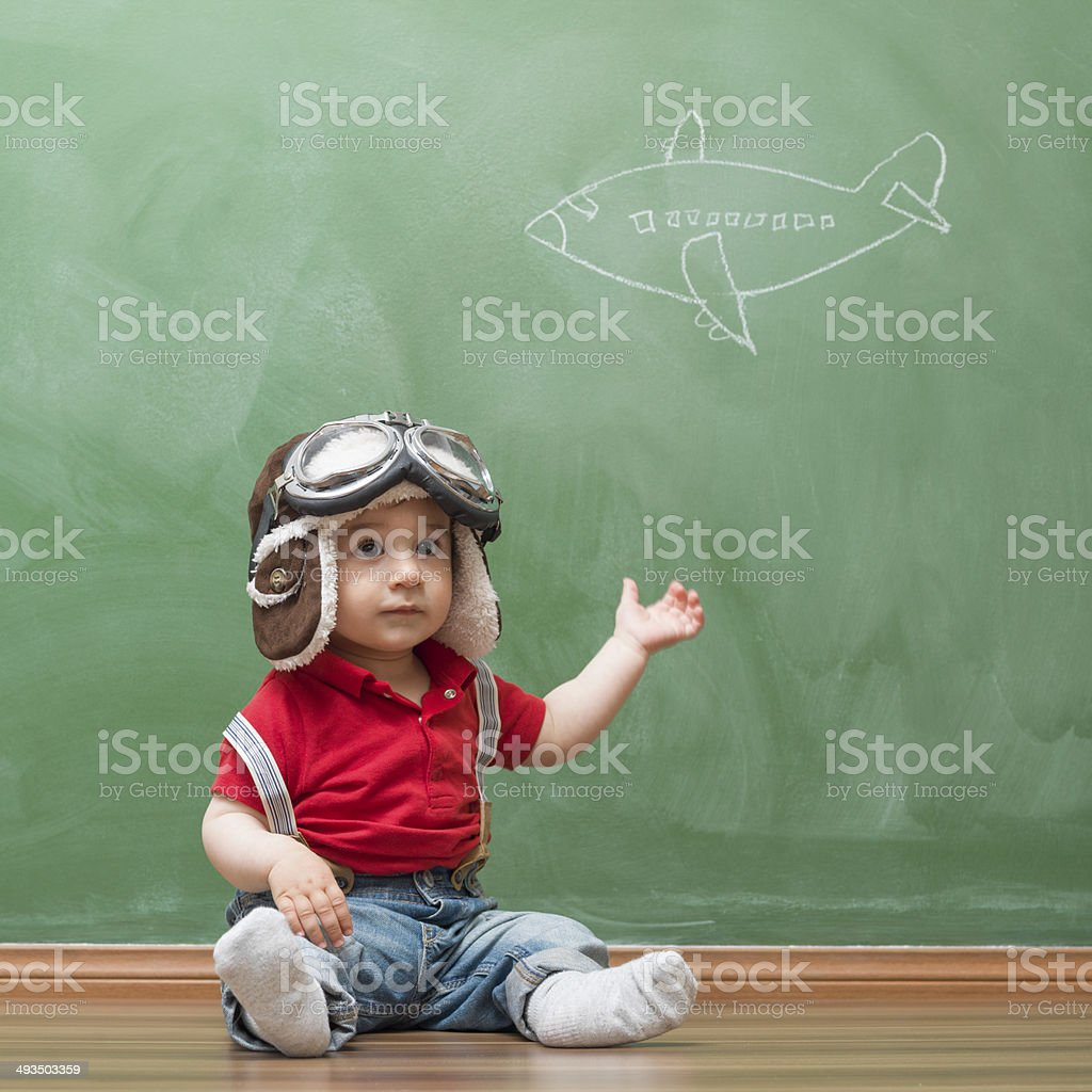 Little boy with flying goggles before blackboard stock photo