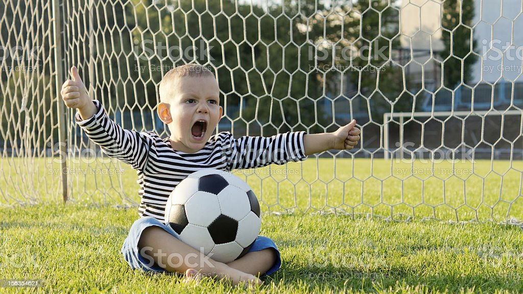 Little boy with football royalty-free stock photo