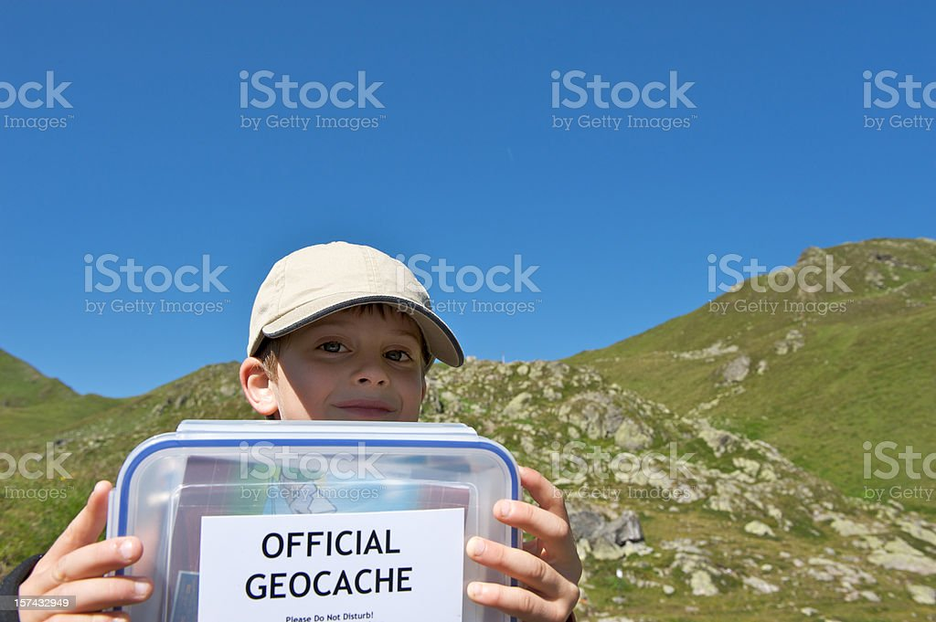 Little boy with geocache stock photo