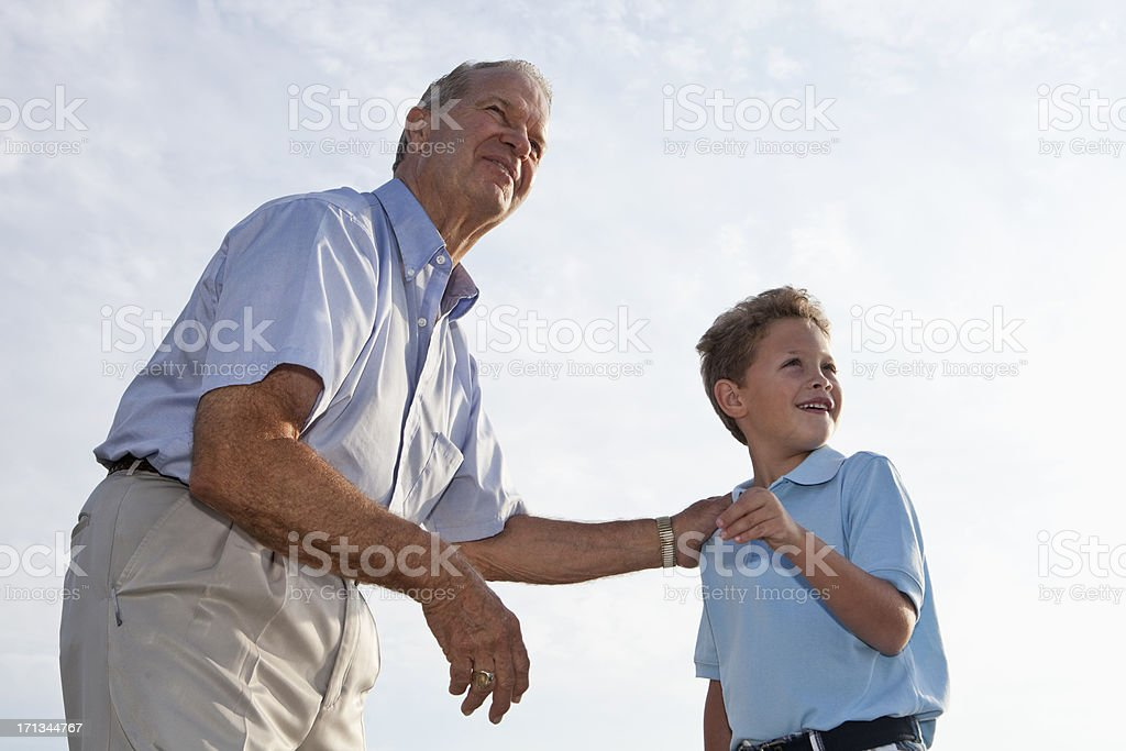 Little boy with grandfather stock photo