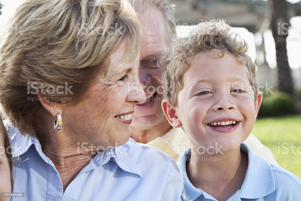 Little boy with grandparents stock photo