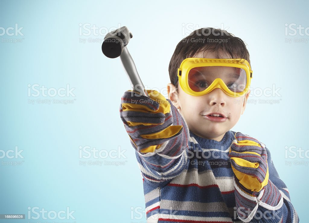 Little boy with hammer royalty-free stock photo