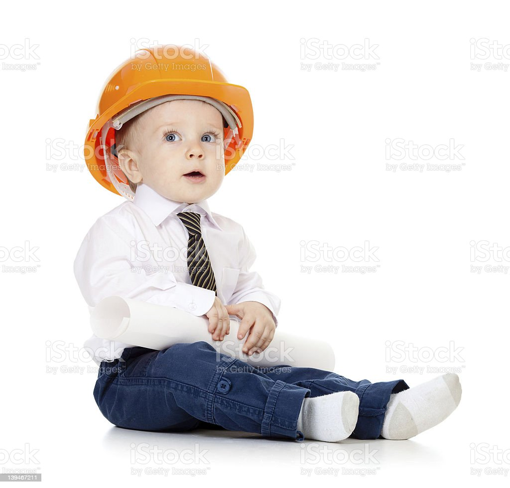 little boy with hard hat and engineering drawing stock photo