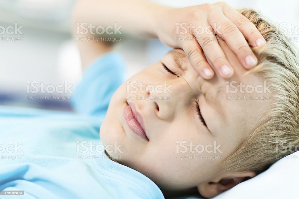 Little boy with headache stock photo