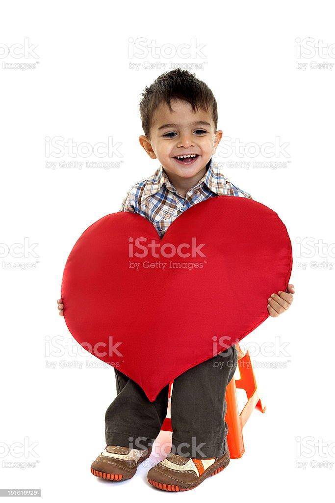 little boy with heart shape stock photo