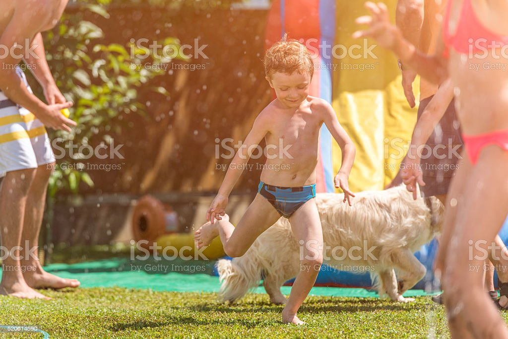 Little boy with his family in the backyard stock photo