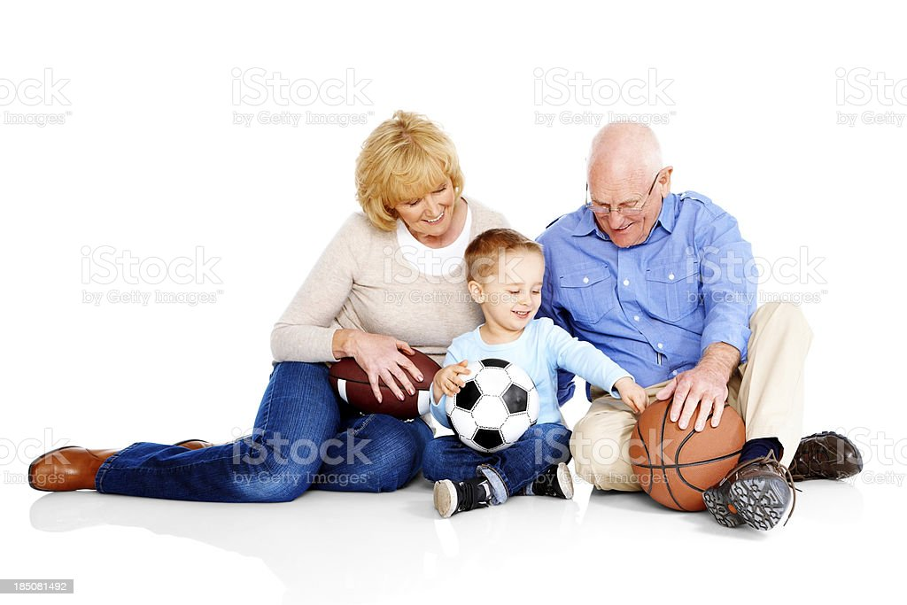 Little boy with his grandparents sitting on white royalty-free stock photo