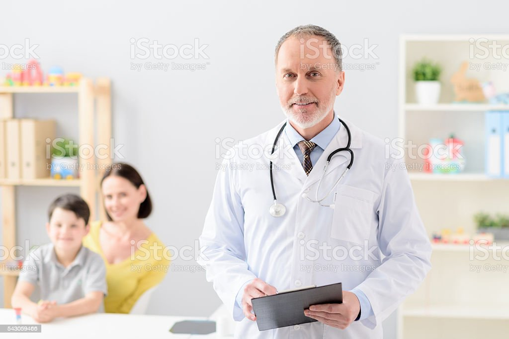 Little boy with his mother at doctor on consultation stock photo
