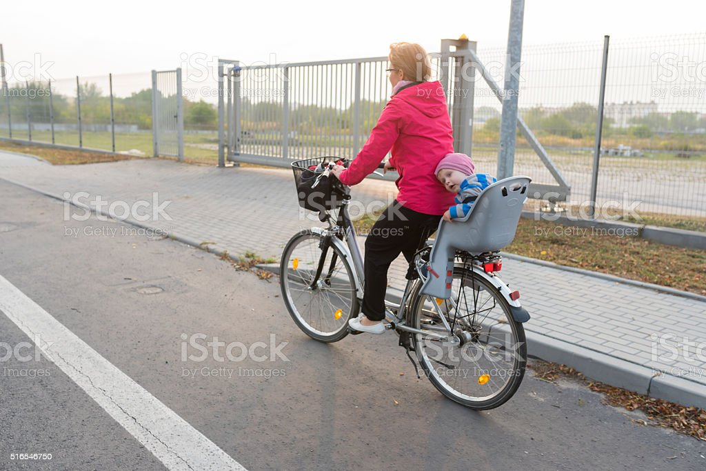 Little boy with his mum on bicycle trip stock photo
