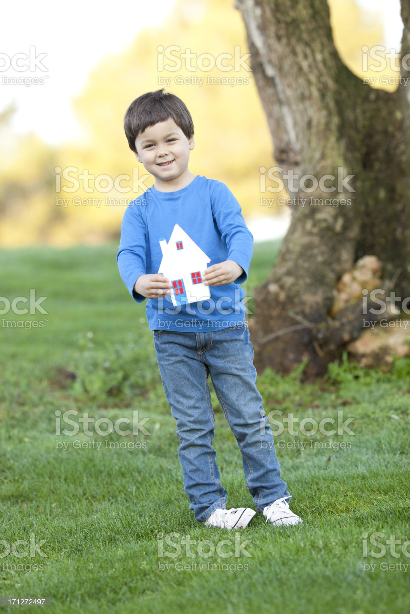 little boy with house-miniature royalty-free stock photo