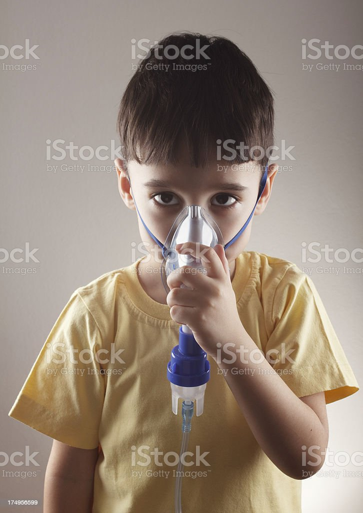 Little boy with inhaler royalty-free stock photo