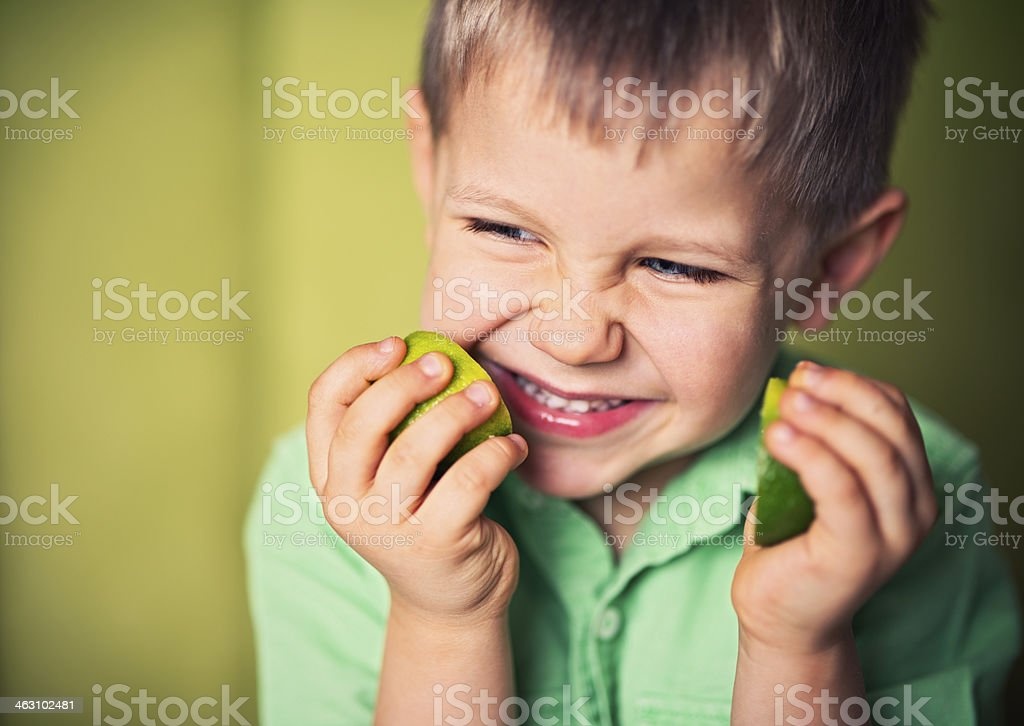 Little boy with lime stock photo
