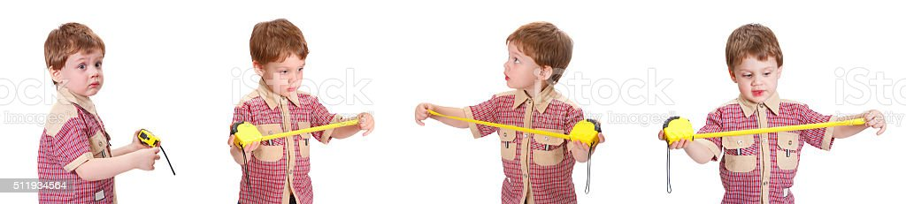 Little boy with measuring roulette on the white stock photo