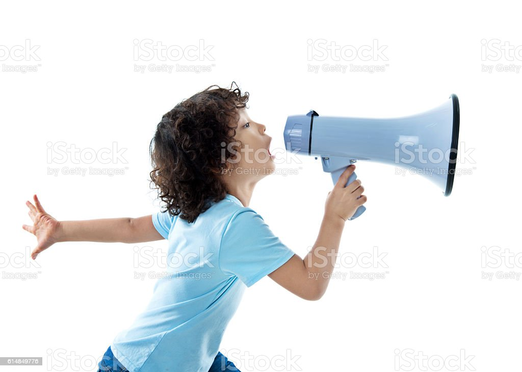 Little boy with megaphone on white background stock photo