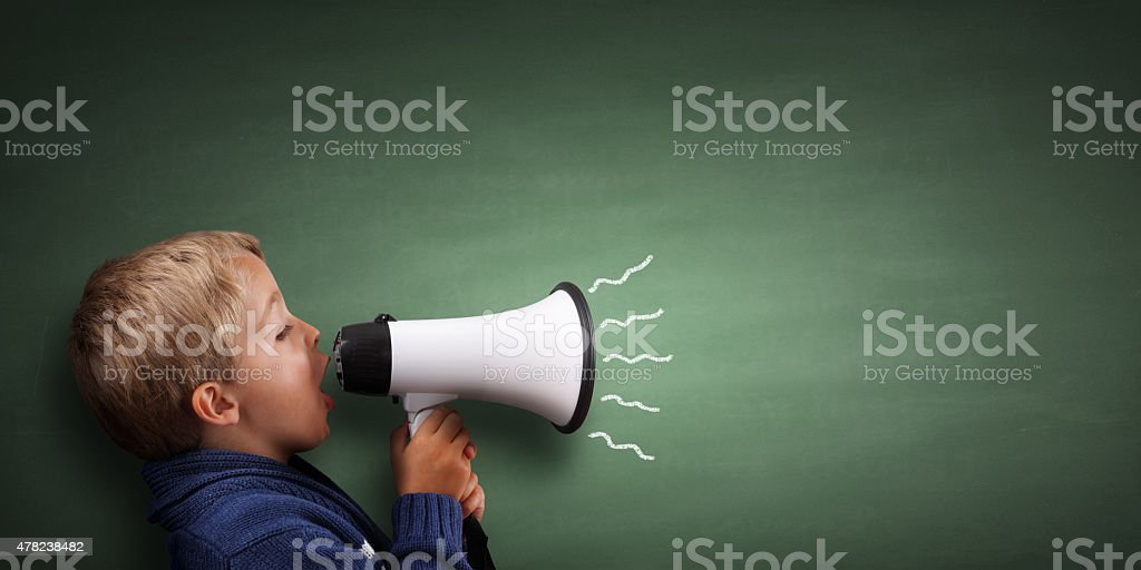Little boy with megaphone stock photo