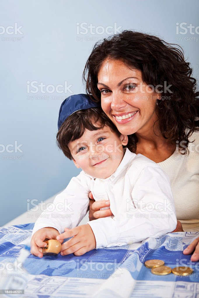 Little boy with mother celebrating Hanukkah stock photo