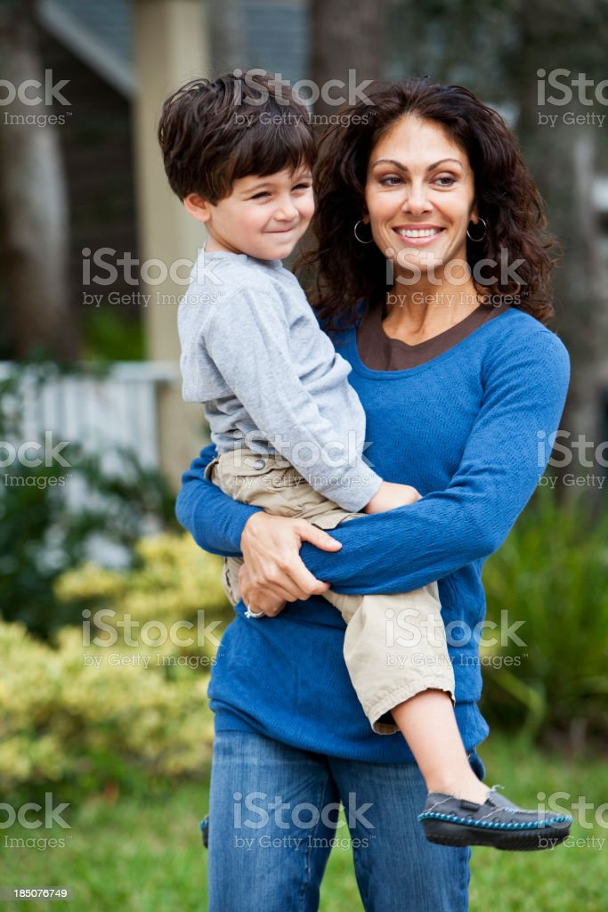 Little boy with mother in front of house stock photo