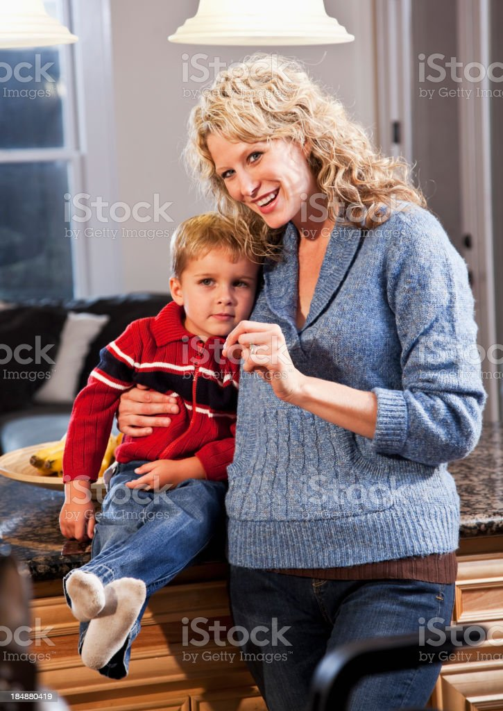 Little boy with mother in kitchen stock photo
