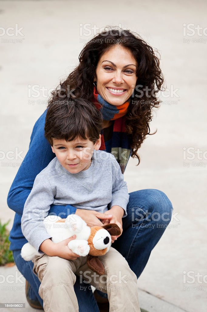 Little boy with mother outdoors stock photo