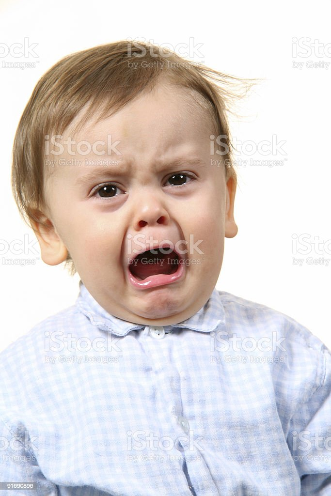 A little boy with mouth open crying stock photo