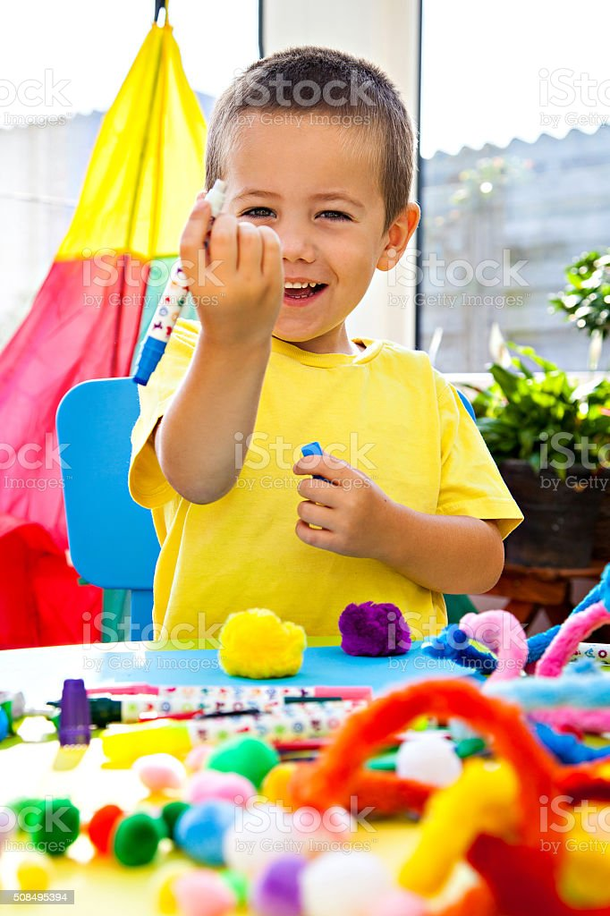 Little boy with pencil stock photo
