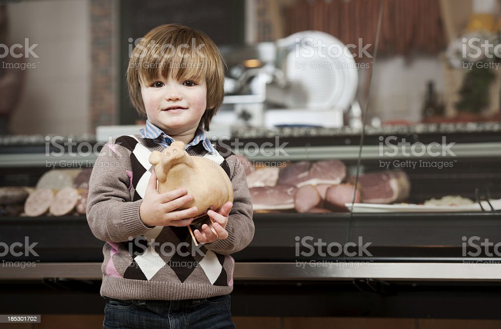 Little boy with piggy bank royalty-free stock photo