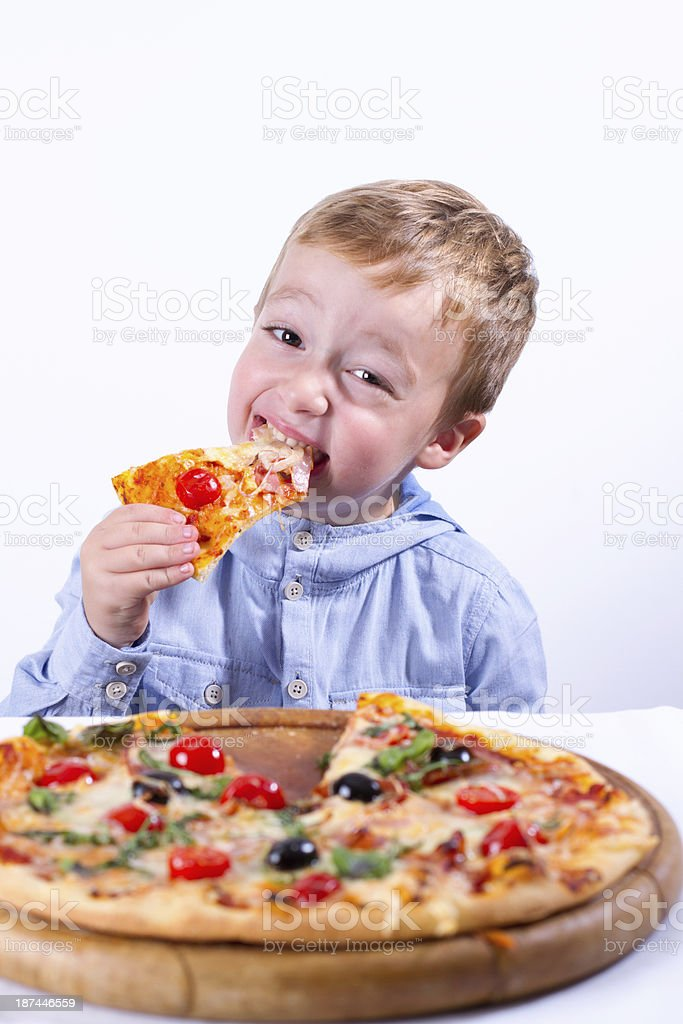Little boy with pizza royalty-free stock photo