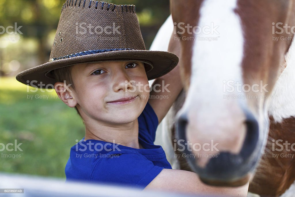 Little boy with pony closeup royalty-free stock photo