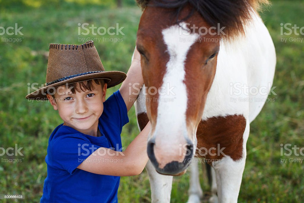 Little boy with pony royalty-free stock photo