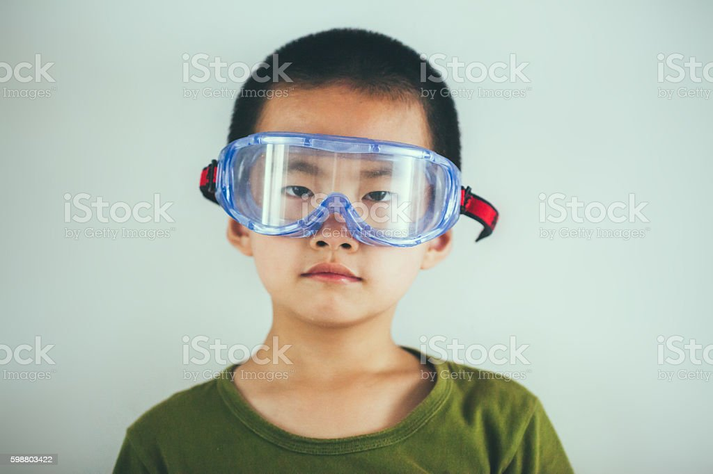 little boy with safety glasses on head stock photo