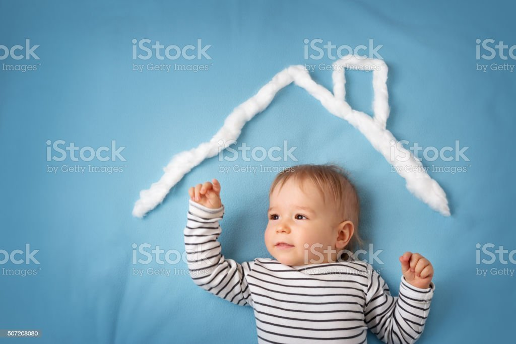 little boy with shape of house stock photo