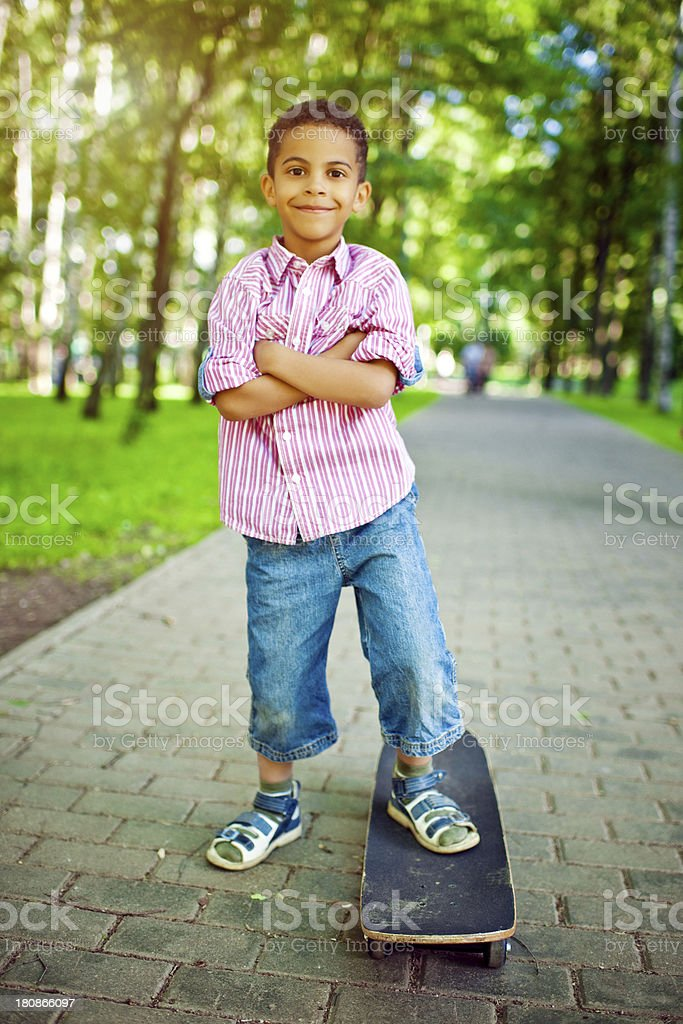 Little boy with skate in park royalty-free stock photo