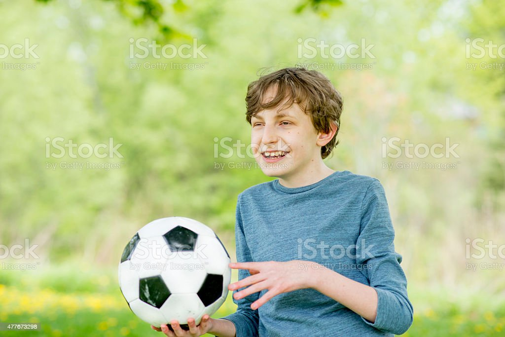 Little Boy with Soccer Ball stock photo