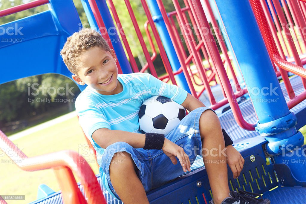 Little Boy With Soccer Ball Sitting In Playhouse royalty-free stock photo