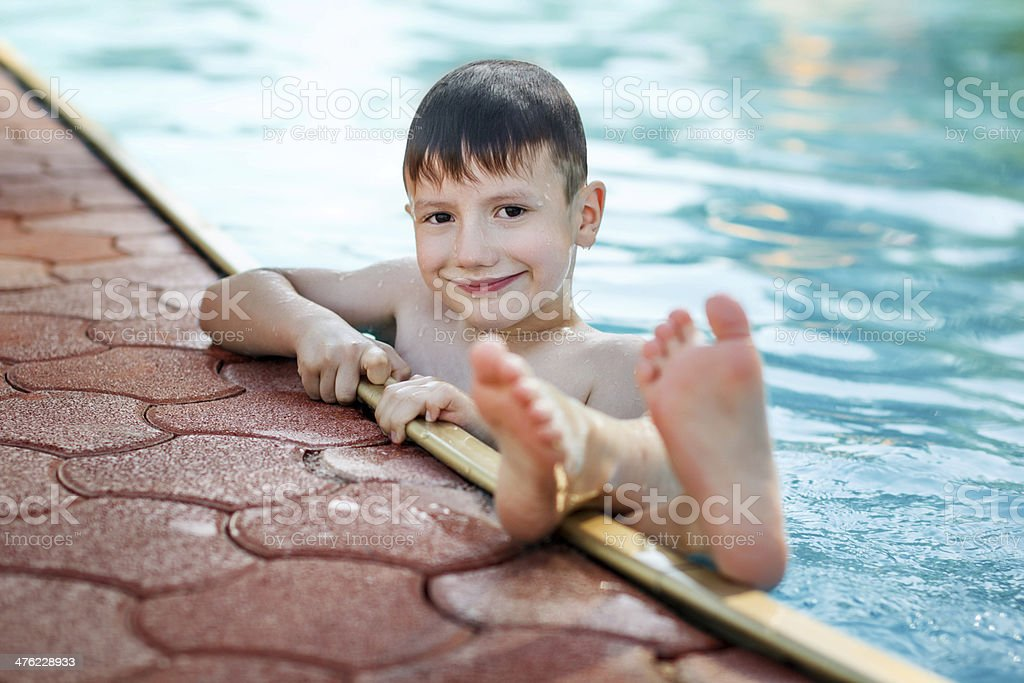 Little boy with sole up in the pool royalty-free stock photo