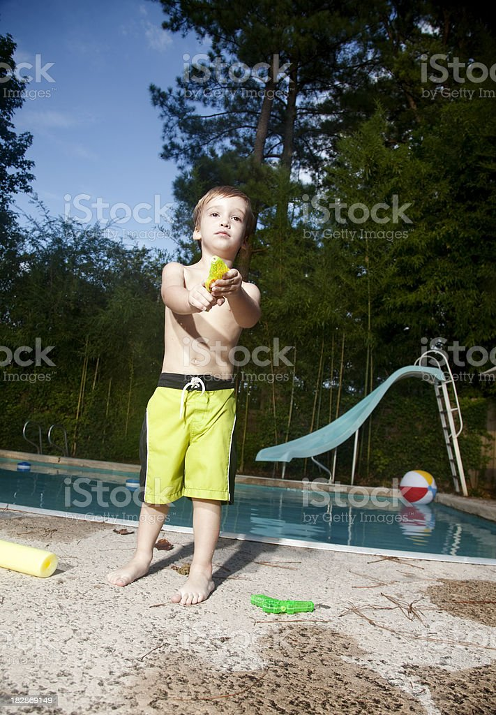Little boy with squirt gun royalty-free stock photo