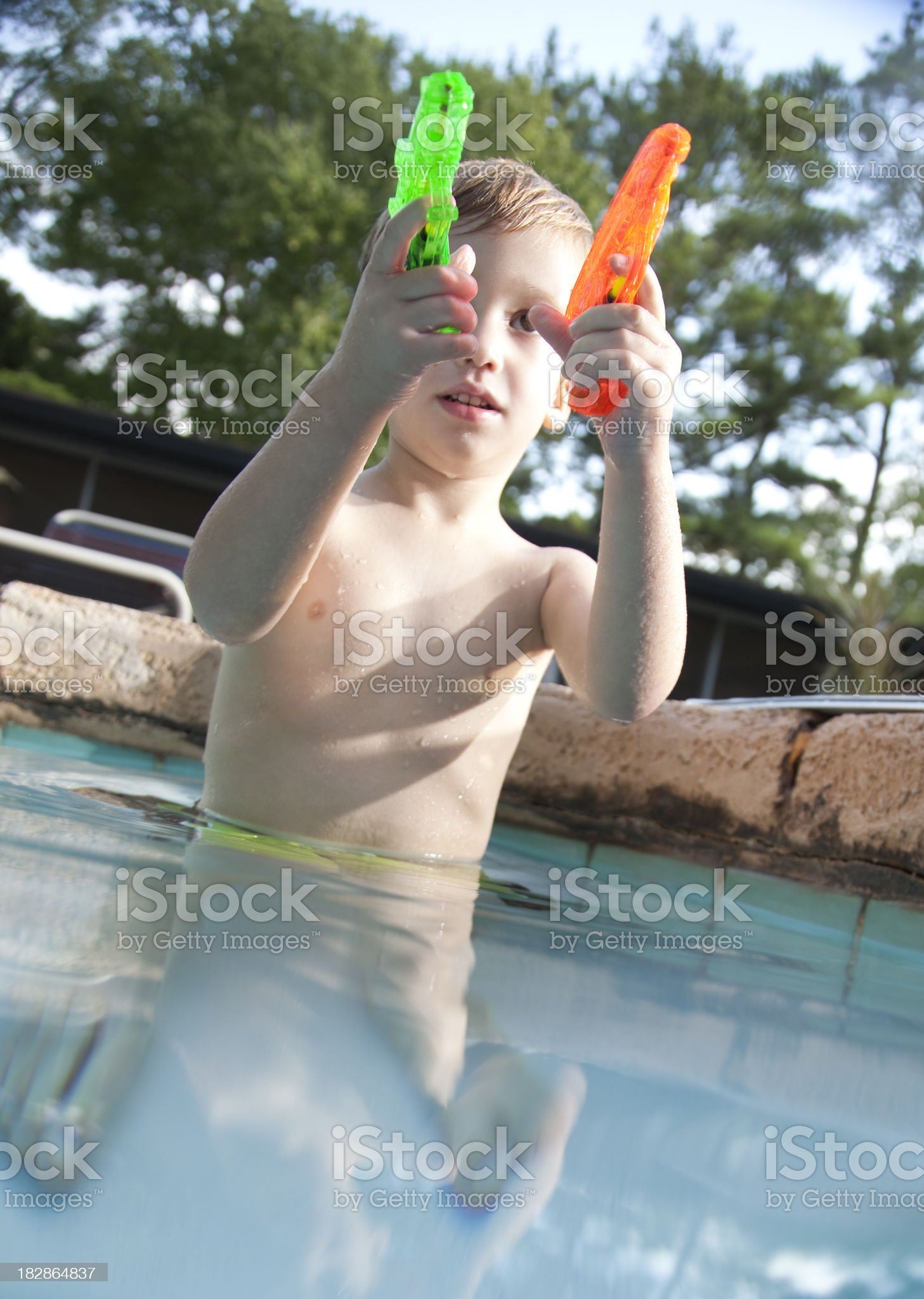 Little boy with squirt guns royalty-free stock photo