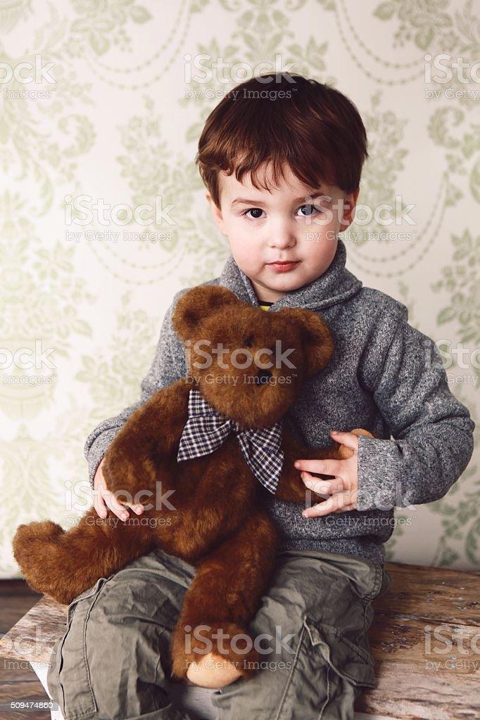 Little Boy with Teddy Bear stock photo