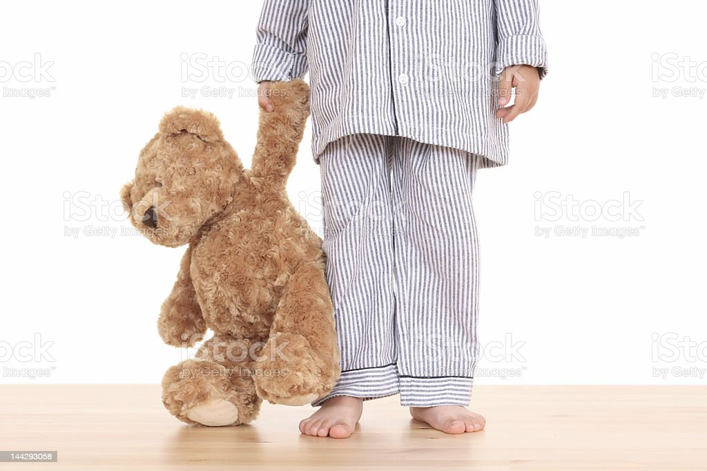 Little boy with teddy bear trying not to go to bed stock photo