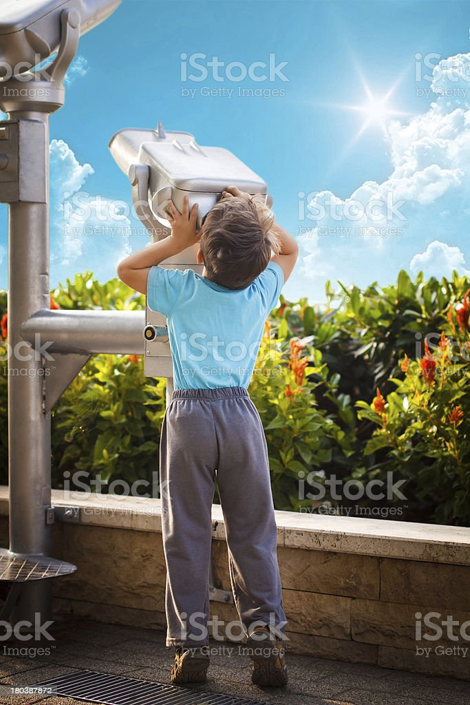 Little boy with telescope gazing the sky royalty-free stock photo