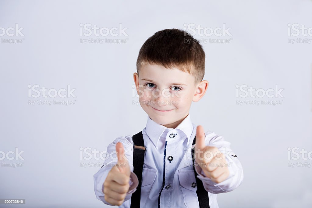Little boy with thumb up gesture stock photo