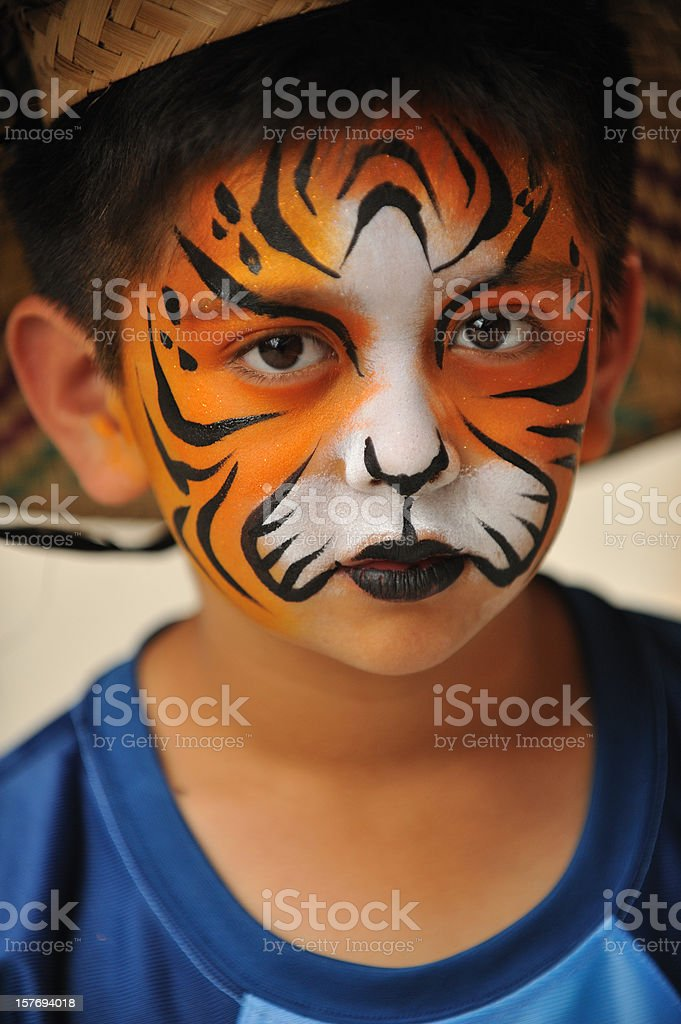 Little boy with tiger mask painted on his face royalty-free stock photo
