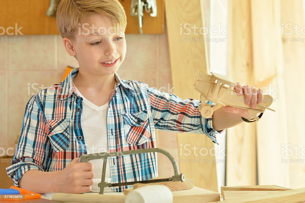 little boy  working with wood stock photo