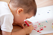 Little boy writing his first letters